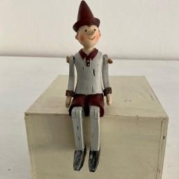 Pinocchio sedící pohyblivé...